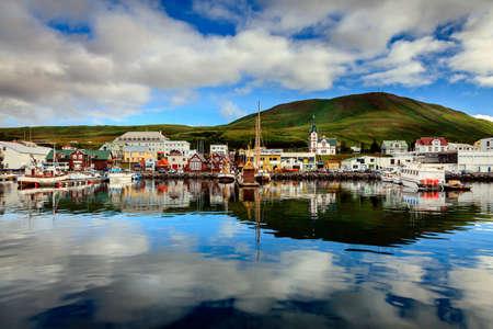 church: Calm morning in Husavik harbor in Northern Iceland