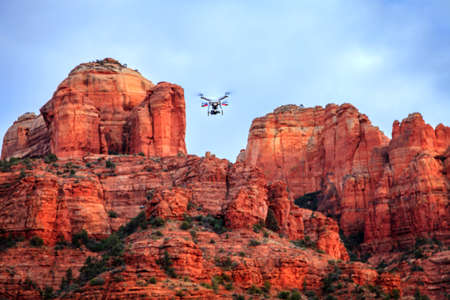 Drone quadcopter is taking aerial footage of Cathedral Rock in Sedona, Arizona
