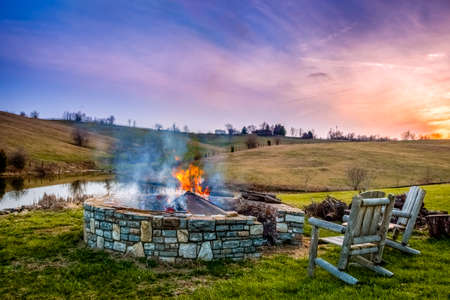 Bonfire in a firepit at sunset in Central Ketucky countryside near Georgetown.