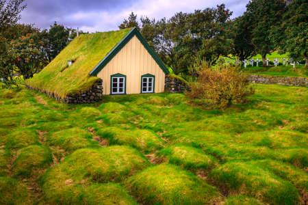 Hofskirkja - a small turf-top church and graveyard in Hof, Iceland
