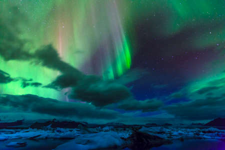 Aurora borealis over Jokulsarlon lagoon in Iceland Stock Photo