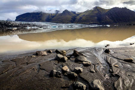 terminus: Fjallsarlon lagoon at a glacier terminus in the south of Iceland