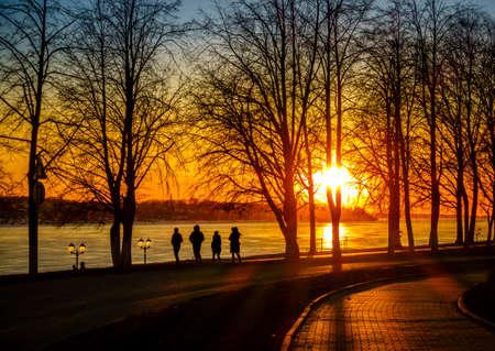 evening glow: Scenic riverwalk along the Volga River in the city of Kostroma, Russia Stock Photo