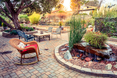 garden landscaping: Evening on a patio in a tranquil garden