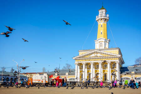 national hero: Kostroma, Russia - March 26, 2015: Pigeons flying over 18th century central square named after Ivan Susanin - a Russian national hero