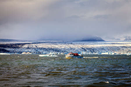 amphibious: Jokulsarlon Lagoon, Iceland - September 13, 2013: Amphibious vehicle takes tourists on iceberg watching tour in Jokulsarlon glacier lagoon in Southern Iceland
