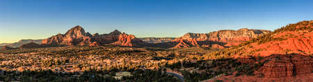 sky: Birds eye panorama of the city of Sedona, Arizona and the Red Rocks at sunset Stock Photo