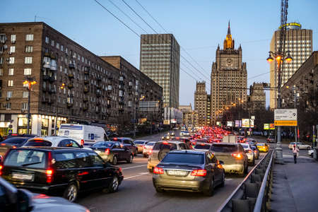 foreign affairs: MOSCOW, RUSSIA - APRIL 4, 2015: Heavy evening traffic on Smolenskaya Street with the Ministry of Foreign Affairs building in the backdrop in Moscow, Russia