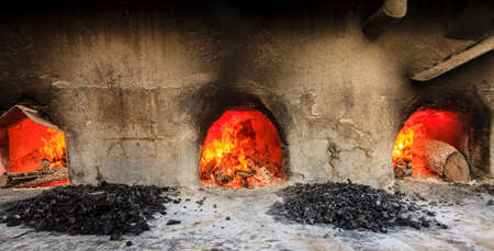 stone fireplace: Wood fired ovens at a halwa factory in Nizwa, Oman