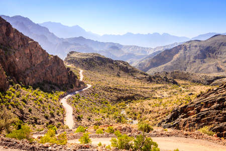 A treacherous road through Al Hajar mountains in Oman Stock Photo