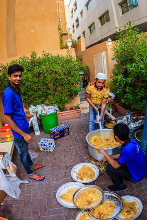 bur dubai: dubai, June 14, 2016: iftar dinner is prepared by volunteers near a mosque in Bur Dubai, UAE Editorial