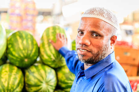 Dubai, June 4, 2016: a vendor with watermelons at the fruit and vegetable market in Dubai, UAE Editorial