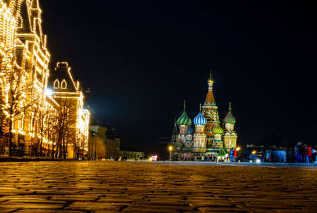 st  basil: Nighttime view of TsUM Department Store and St. basil Cathedral on the Red Square in Moscow, Russia Stock Photo