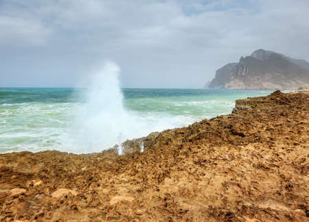 Ocean surf near Al Mughsayl beach in Salalah, Oman during monsoon season Stock Photo