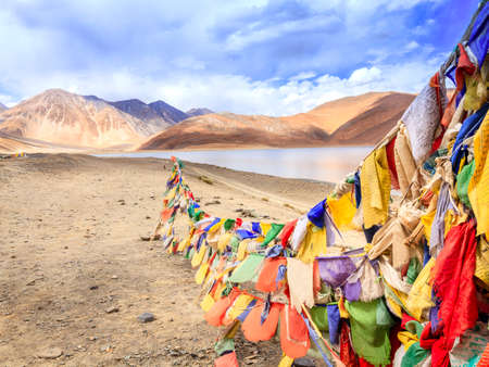 Buddhist prayer flags at Pangong Tso - alpine lake in the Himalayas on the China-India border