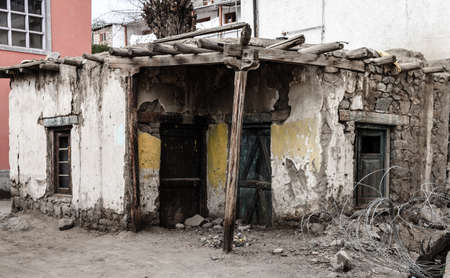 Dilapidated old house in residential area of Leh, Ladakh, India