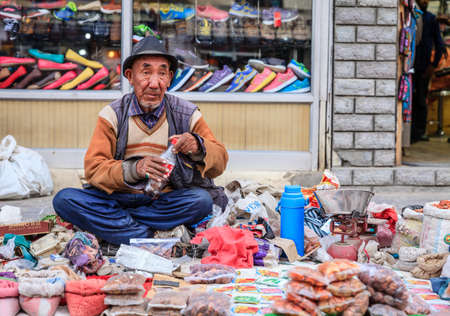 Leh, Ladakh, India, July 14, 2016: local man is selling spices on a sidewalk market in Leh, Ladakh district of Kashmir, India