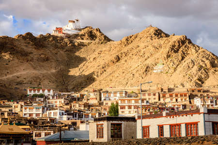 View to a residential area of city of Leh and Namgyal Tsemo Monastery in Ladakh region of Kashmir, India Stock Photo