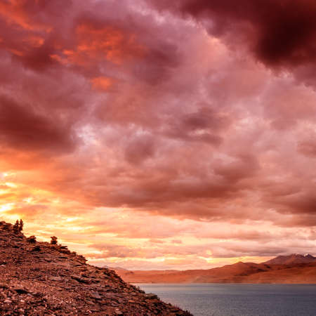 Dramatic sunset sky over lake Tso Moriri in the Himalayas, Kashmir, India