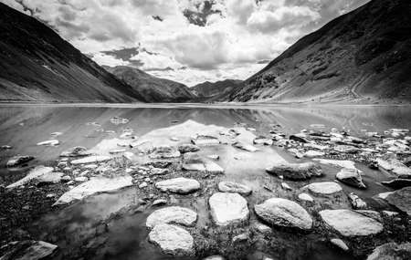Small lake in highlands of Ladakh region of Kashmir, India. Black and white.