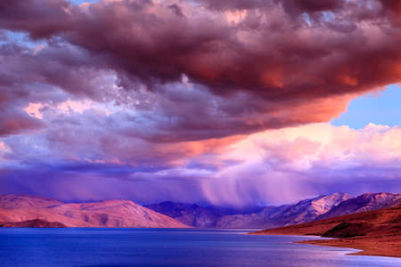 Storm at sunset over lake Tso Moriri in the Himalayas, Kashmir, India Stock Photo