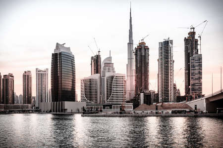 Scenic view of skyline of Dubais downtown at sunset Editorial
