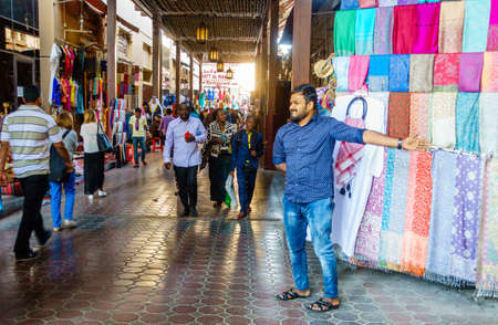 Dubai, UAE, February 5, 2016: Bustling shopping street of Dubai Textile Souk in Bur Dubai Editorial