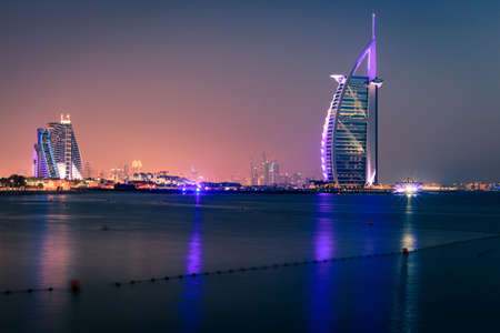 Dubai, UAE, June 7, 2016: view of world's famous Burj Al Arab and Jumeirah Beach hotels at night Editorial