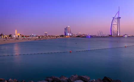 Dubai, UAE, June 7, 2016: view of world's famous Burj Al Arab hotel and Jumeirah Beach at dusk
