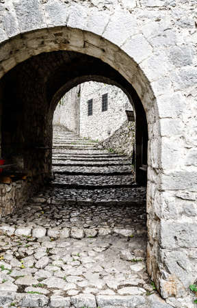 Medieval cobblestone street in a small Bosnian town of Pocitelj