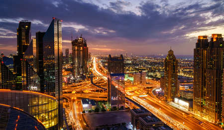 Birds eye view of Dubai skyline and rush hour traffic in downtown at night Stock Photo