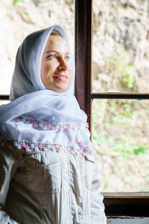 Portrait of a woman wearing traditional headscarf at a Dervish monastery in Bosnia