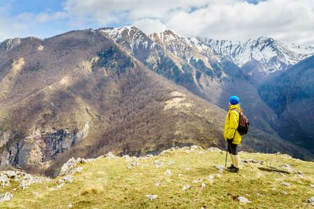 Woman is hiking in Dinaric Alps near Sarajevo, Bosnia-Herzegovina Stock Photo