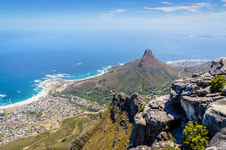 View of Lions Head Mountain and Camps Bay from Table Mountain in Cape Town, South Africa Stock Photo