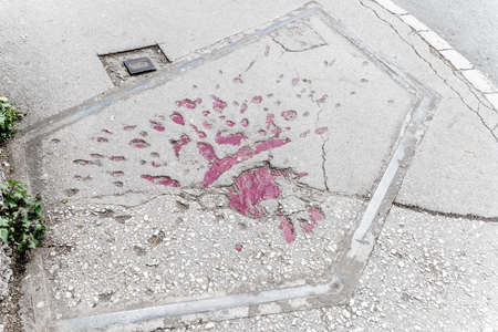 Markings on the streets of Sarajevo indicating where mortar shells exploded during Bosnian war in 1990s