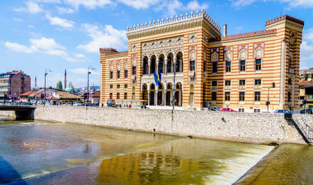 Historic Sarajevo City Hall on Miljacka River in the old city center