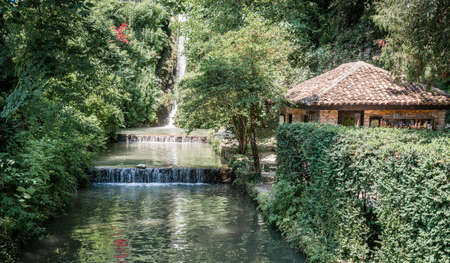 Waterfall in botanical gardens of Balchik Palace in Bulgaria Stock Photo