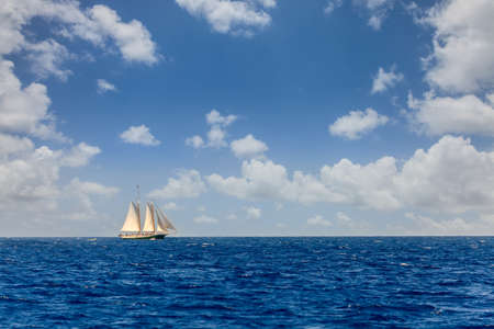 Sailboat on a bright sunny day in an open sea in British Virgin Islands