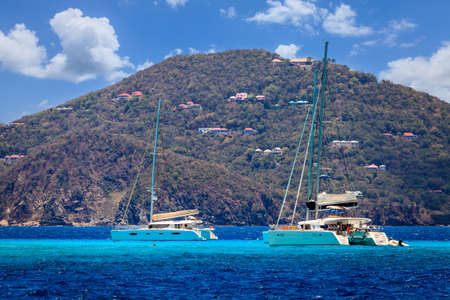 Luxury sailing catamarans near a resort island in BVI Stock Photo