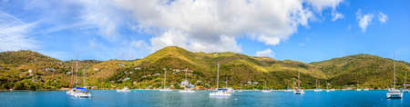 Panoramic view of a harbor with anchored sailboats in BVI Stock Photo