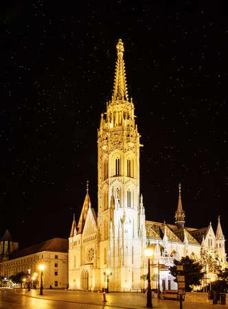 Nighttime view of Matthias Church in Budapest, Hungary