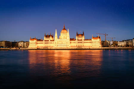 Beautiful view of Hungarian Parliament Bulding reflecting in the Danube River at night Stock Photo
