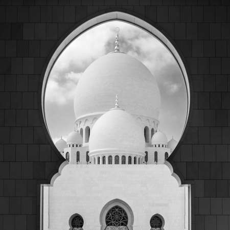 View of main dome of the Sheikh Zayed Grand Mosque framed by an arch. Abu Dhabi, UAE
