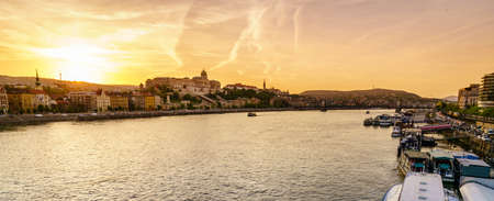 View of Buda side of Budapest and Buda Castle from the Danube River at sunset