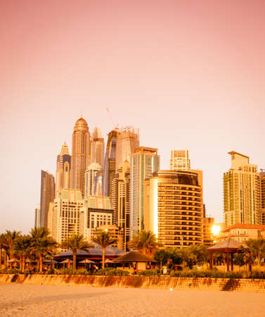 View of Dubai Marina skyscrapers from the seaside at sunset. Dubai, UAE Stock Photo