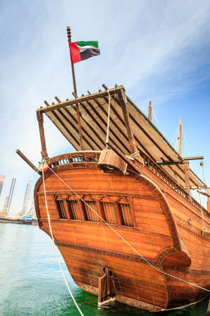 Bow of a traditional Arabian ship moored by Corniche in Sharjah, UAE