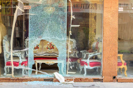Broken window of a furniture shop in Sharjah, UAE Stock Photo