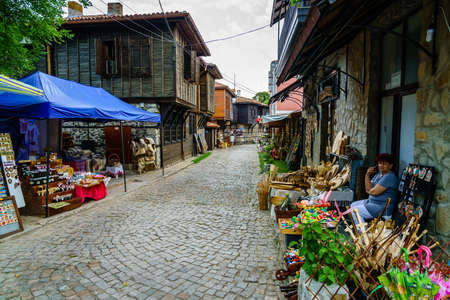 Sozopol, Bulgaria, June 27, 2017: an old cobblestone street lined with souvenir shops in resort town of Sozopol, Bulgaria Editorial