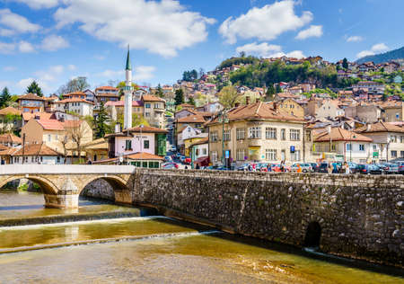 Sarajevo, Bosnia-Herzegovina, April 9, 2017: Miljacka River embankment in Sarajevo city center on a sunny spring day