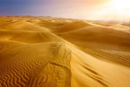 Sand dunes in the desert near Al Ain, UAE at sunrise Stock Photo